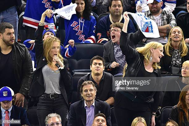 Freya St Johnston Liam Neeson and guest attend the Tampa Bay Lightning vs New York Rangers playoff game at Madison Square Garden on May 29 2015 in...