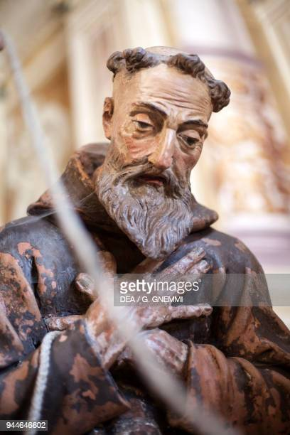 Friar detail of Saint Francis lead naked through the streets of Assisi polychrome terracotta statue by Giuseppe Rusnati and Bernardo Falcone 13th...