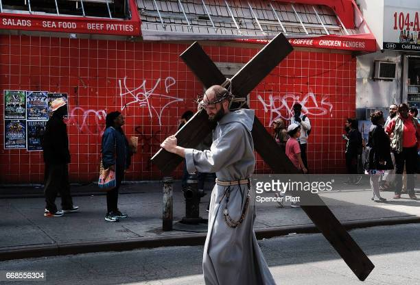 A friar from St Joseph Friary walks the Way of the Cross through the streets of Harlem on April 14 2017 in New York City Over 50 people joined the...