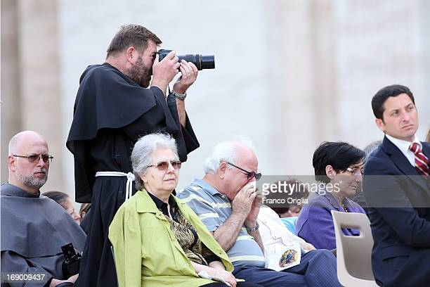 A friar takes pictures during the celebration of Pentecost Vigil with lay Ecclesial movements held in St Peter's Square by Pope Francis on May 18...