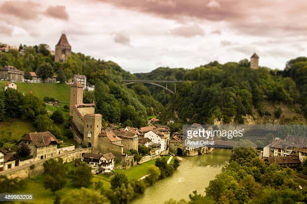 CONTENT] Fribourg Switzerland Europe river water sunset old ancient city wall towers medieval vegetation landscape valley travel