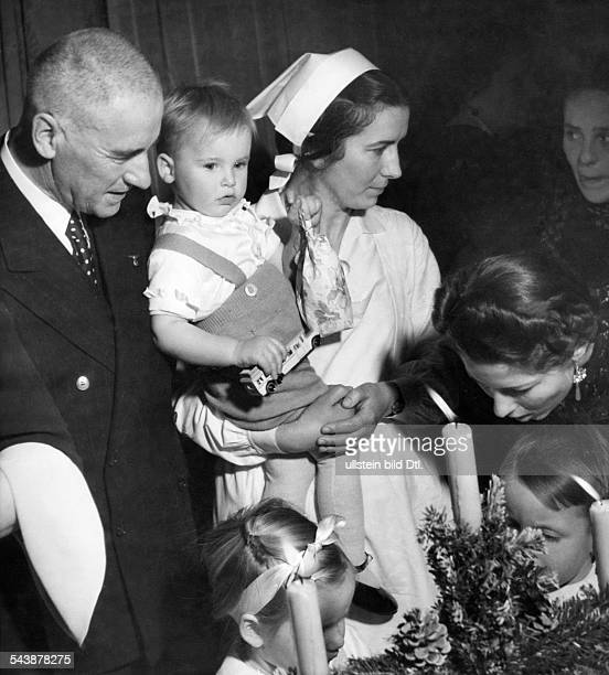 Frick Wilhelm Politician NSDAP Germany*12031877Minister of the Interior of the Third Reich 193343 With his wife and children at a Christmas party...
