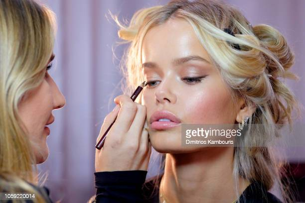 Frida Aasen prepares backstage during the 2018 Victoria's Secret Fashion Show in New York at Pier 94 on November 8 2018 in New York City