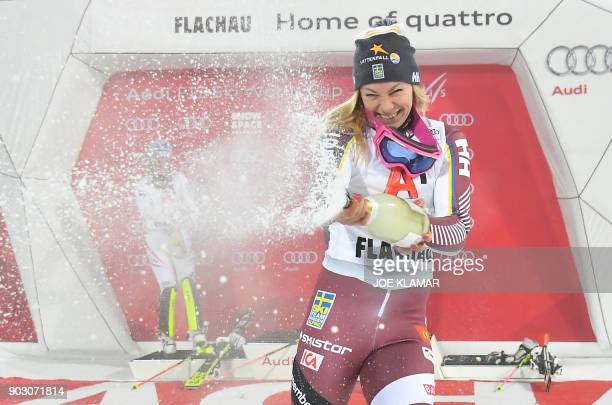 Frida Hansdotter of Sweden celebrates her 3rd place with champagne on the podium of the FIS World Cup Ladies night Slalom race in Flachau Austria on...