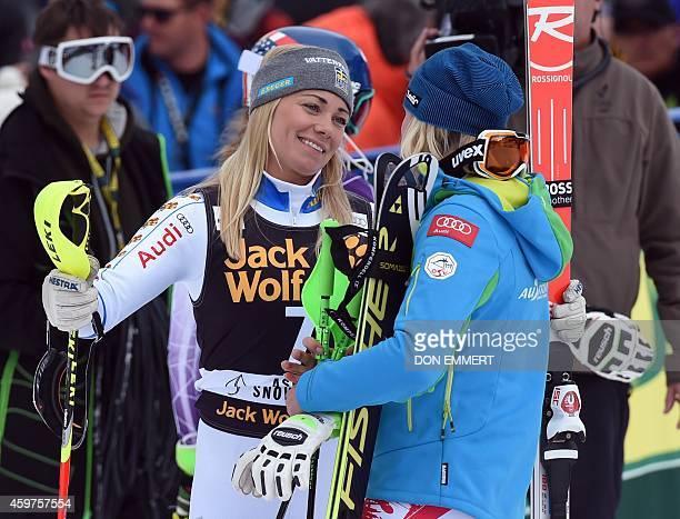 Frida Hansdotter of Sweden congratulates Nicole Hosp of Austria during the 2014 Audi FIS Ski World Cup slalom at the Nature Valley Aspen...