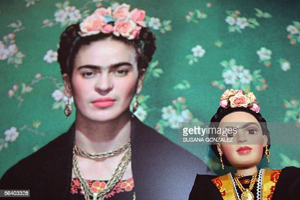 Frida Kahlo doll is seen next to a picture of the Mexican artist at a doll factory in Mexico City 09 December 2005 A first edition of 250000 dolls...