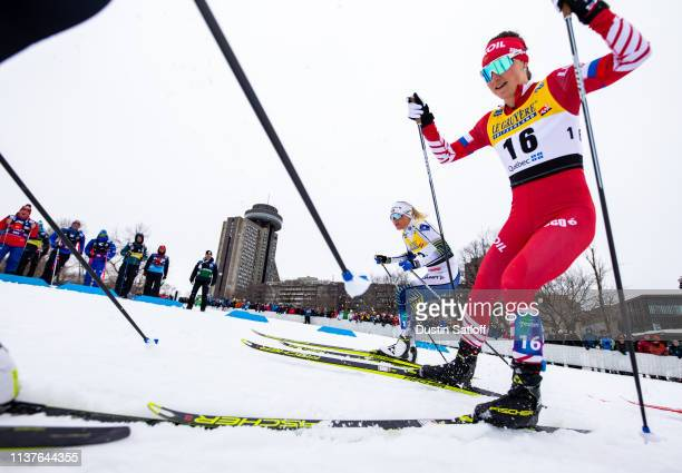 Frida Karlsson of Sweden and Yulia Belorukova of Russia competes in the sprint quarterfinal heat during the FIS Cross Country Ski World Cup Final on...