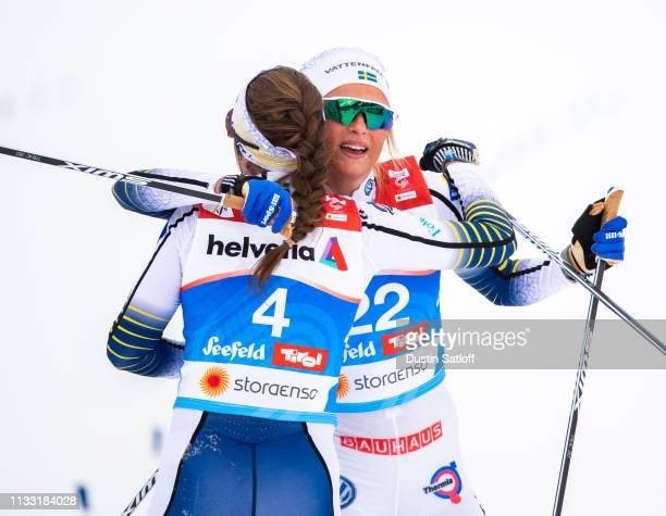 Frida Karlsson of Sweden hugs Ebba Andersson of Sweden in the finish area after the Women's 30km Cross Country mass start during the FIS Nordic World...