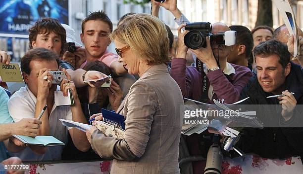 Frida Reuss of the legendary Swedish pop group ABBA signs autographs to fans as she arrives for the World Premiere of the film Mamma Mia on June 30...