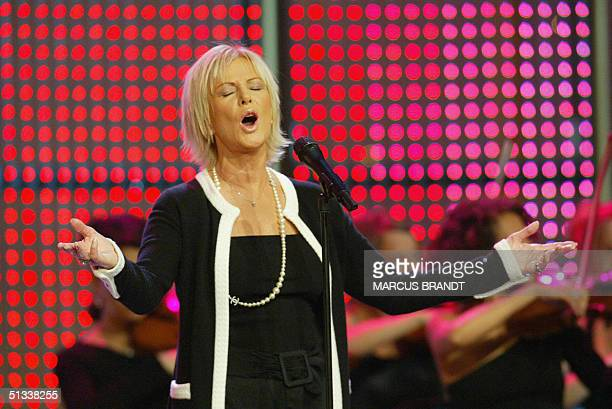Frida singer of the former Swedish pop group 'ABBA' performs during a gala of the 'Golden Hen'awarding in Berlin 22 September 2004 The 'Golden Hen'...