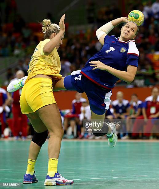 Frida Tegstedt of Sweden challenges Daria Dmitrieva of Russia during the Womens Preliminary Group B match between Russia and Sweden at Future Arena...