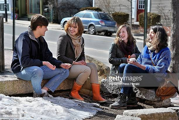 """Friday, March 15, 2013. Friends enjoy a """"decadent sushi lunch"""" complemented with carrots and humous, they got at Rosemont Market on Munjoy Hill...."""