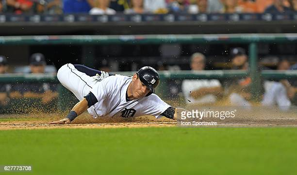 Detroit Tigers Second base Ian Kinsler [4986] reaches back in vain to tap home plate after trying to tag up and score from third base in the third...