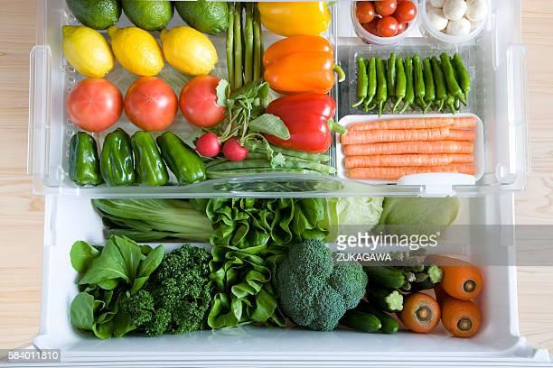 Fridge drawers full of vegetables