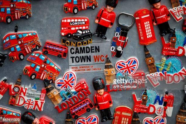 Fridge magnets celebrating London are on sale at Camden Lock Market in London on September 3 2017 / AFP PHOTO / Tolga Akmen