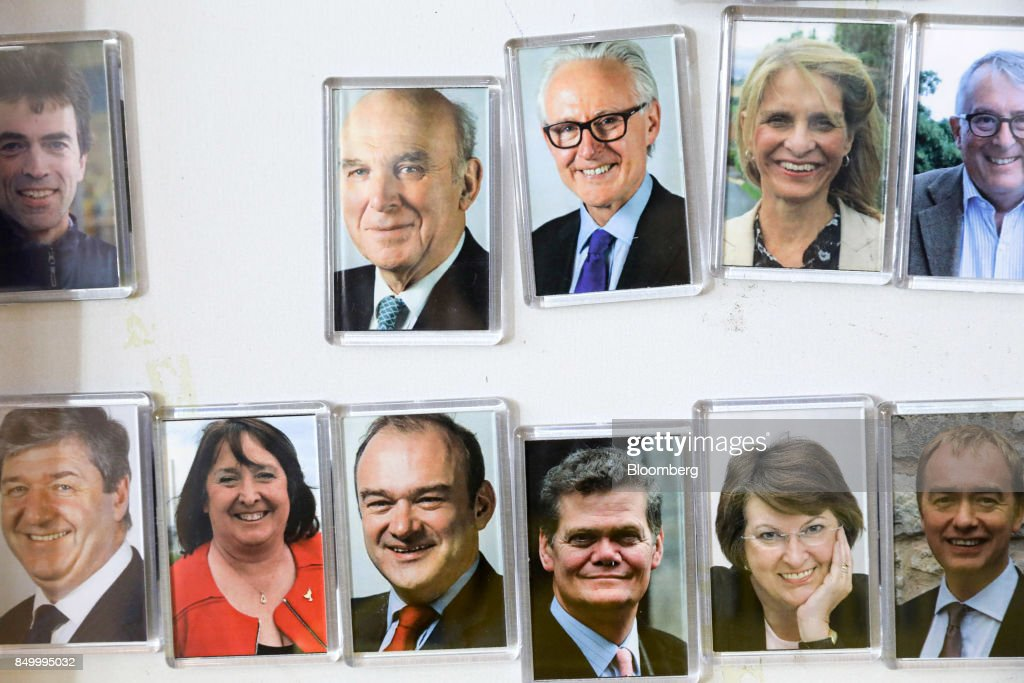 Fridge magnets of members of parliament from the U.K. Liberal Democrat Party, including Vince Cable, leader of the Liberal Democrat Party, top row, second left, are displayed for sale at the party's annual conference in Bournemouth, U.K., on Tuesday, Sept. 19, 2017. Cable said U.K. Prime Minister Theresa May should fire her foreign secretary, Boris Johnson, over an article he published on Saturday about Britains departure from the European Union. Photographer: Luke MacGregor/Bloomberg via Getty Images