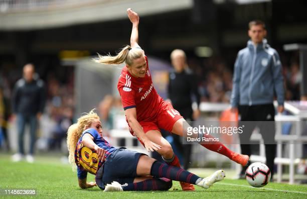 Fridolina Rolfo of Bayern Munich is challenged by Kheira Hamraoui of Barcelona during the UEFA Women's Champions League Semi Final second leg match...