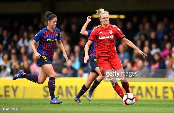 Fridolina Rolfo of Bayern Munich is put under pressure by Marta Torrejon of Barcelona during the UEFA Women's Champions League Semi Final second leg...