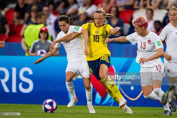 Fridolina Rolfo of Sweden battles for the ball with Jessie Fleming of Canada during the 2019 FIFA Women's World Cup France Round Of 16 match between...
