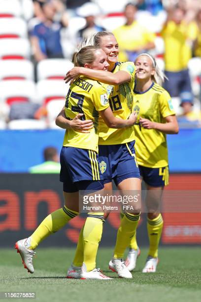 Fridolina Rolfo of Sweden celebrates with teammate Elin Rubensson after scoring her team's third goal during the 2019 FIFA Women's World Cup France...