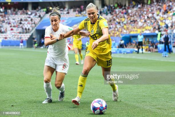 Fridolina Rolfo of Sweden competes for the ball with Lucy Bronze of England during the 2019 FIFA Women's World Cup France 3rd Place match between...