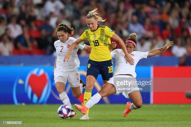 Fridolina Rolfo of Sweden is tackled by Allysha Chapman of Canada and Desiree Scott of Canada during the 2019 FIFA Women's World Cup France Round Of...