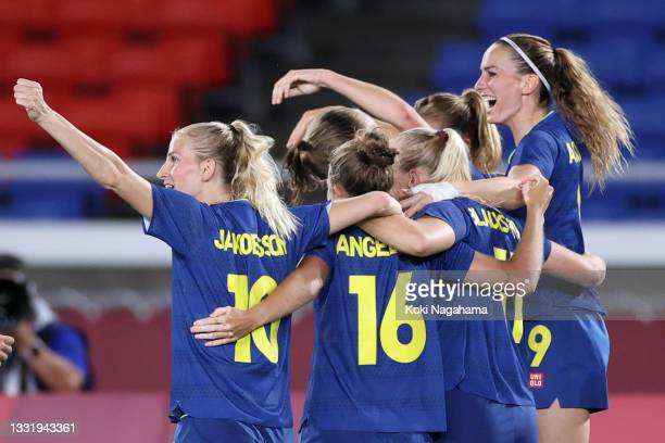 Fridolina Rolfo of Team Sweden celebrates with team mates after scoring their side's first goal during the Women's Semi-Final match between Australia...
