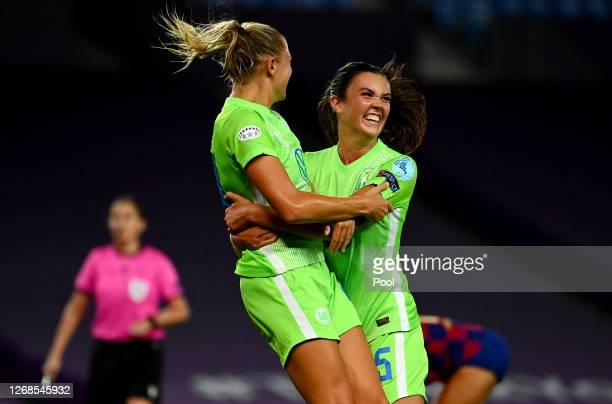 Fridolina Rolfo of Vfl Wolfsburg celebrates with teammate Ingrid Syrstad Engen of Vfl Wolfsburg after scoring their team's first goal during the UEFA...