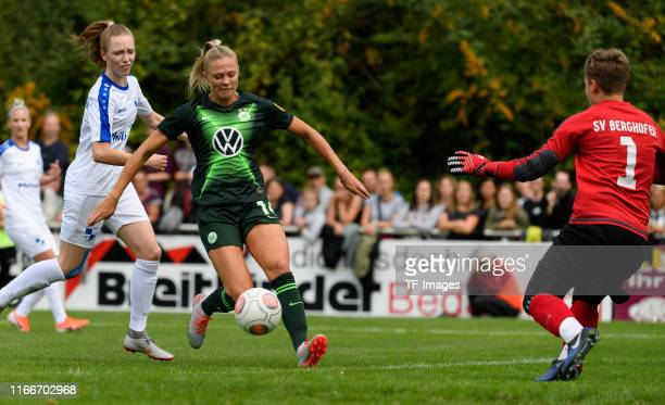 Fridolina Rolfoe of VfL Wolfsburg and goalkeeper Juliane Bauch of SV Berghofen battle for the ball during the Women's DFB Cup second round match...