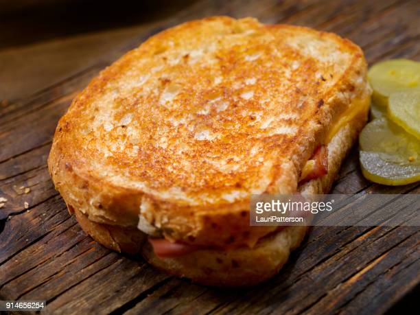 fried bologna, grilled cheese sandwich with sweet pickles on light rye bread - sliced pickles stock photos and pictures