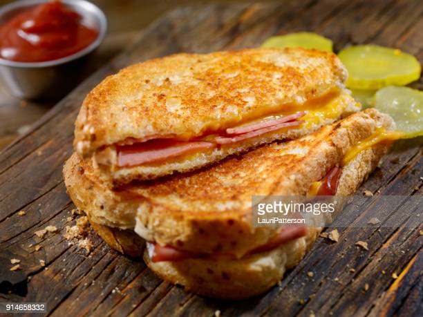 fried bologna, grilled cheese sandwich with sweet pickles on light rye bread - ham stock pictures, royalty-free photos & images