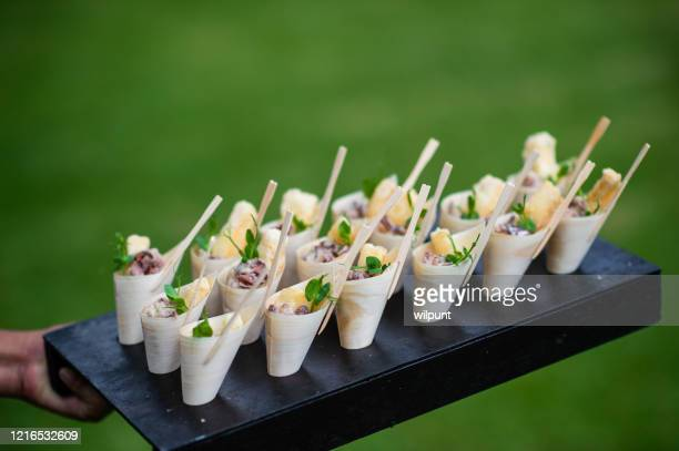 fried calamari scampi bamboo cone appetisers canapés served - serving size stock pictures, royalty-free photos & images