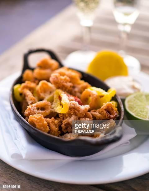 Fried calamari with sauce and lemon