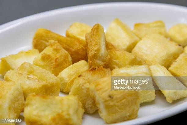 fried cassava - marcelo nacinovic stock pictures, royalty-free photos & images