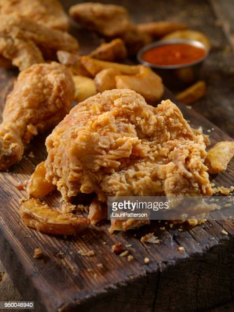 fried chicken and fries - fried chicken stock pictures, royalty-free photos & images