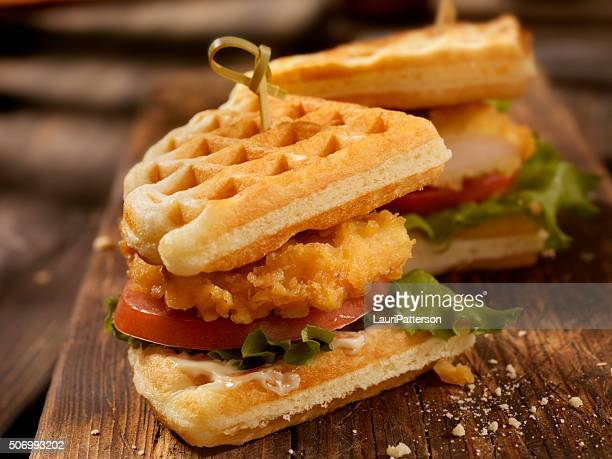 fried chicken and waffle sandwich - chicken and waffles stock photos and pictures