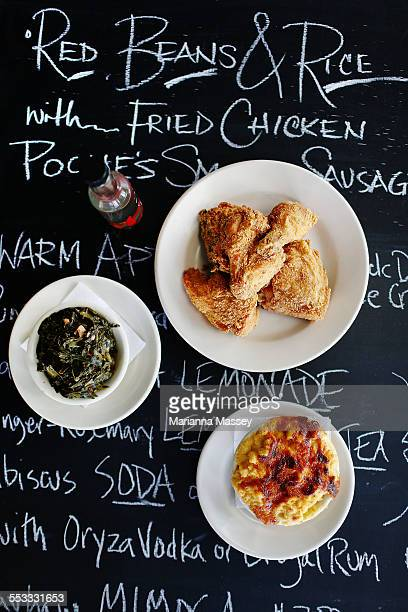 fried chicken, collard greens and mac and cheese - fried chicken stock photos and pictures