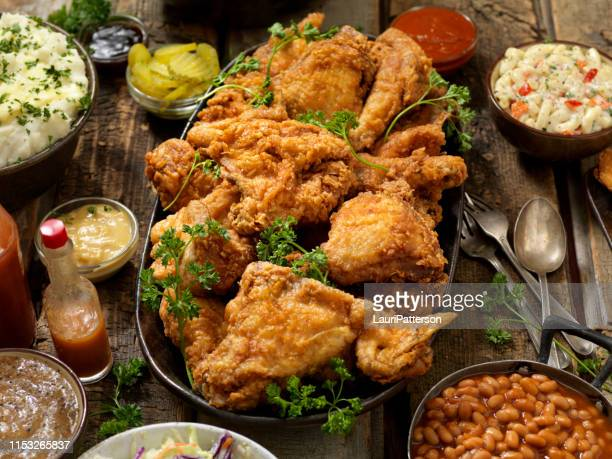 fried chicken feast - fried chicken stock pictures, royalty-free photos & images