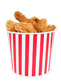 Fried chicken in big red white stripes bucket box
