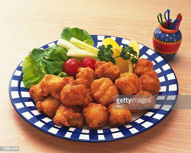 Fried chicken nuggets on plate, high angle view