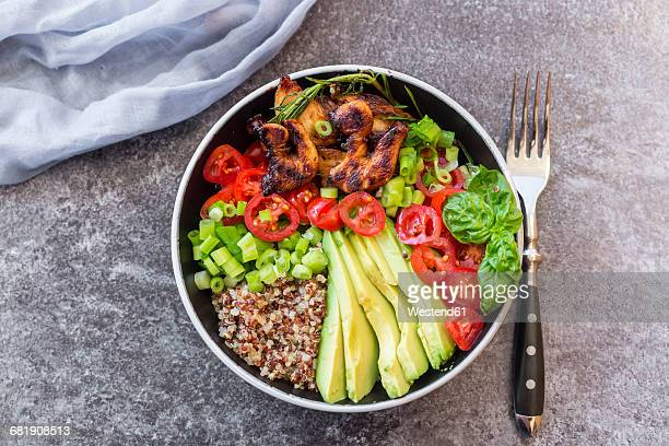 Fried chicken, quinoa, tomato, avocado, spring onion, rosemary and basil in bowl