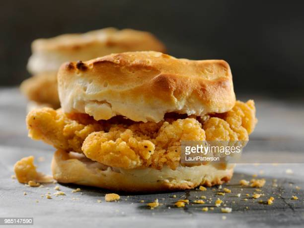 fried chicken sandwich  on a biscuit - biscuit stock photos and pictures