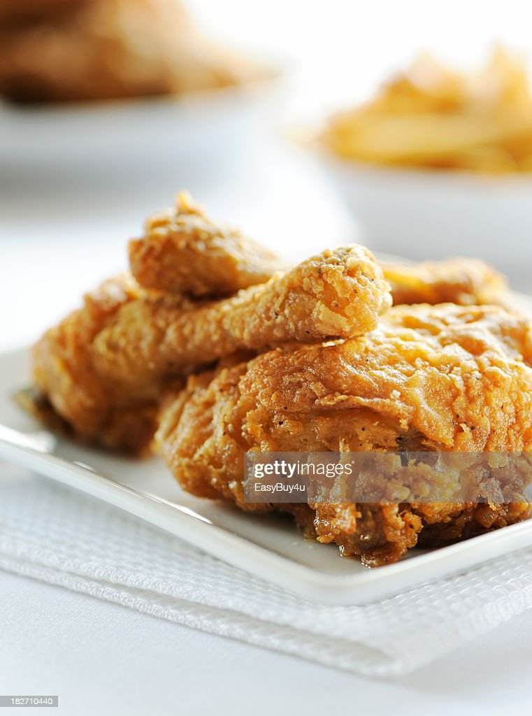 Fried chicken served on white plate : Stock Photo