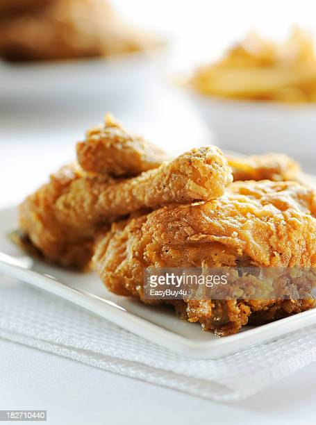 Fried chicken served on white plate