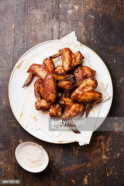 Fried Chicken Wings with sauce on wooden background
