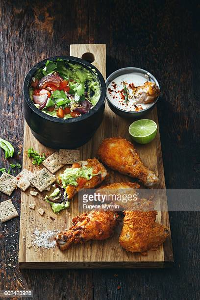 fried chicken with guacamole - breaded stock photos and pictures