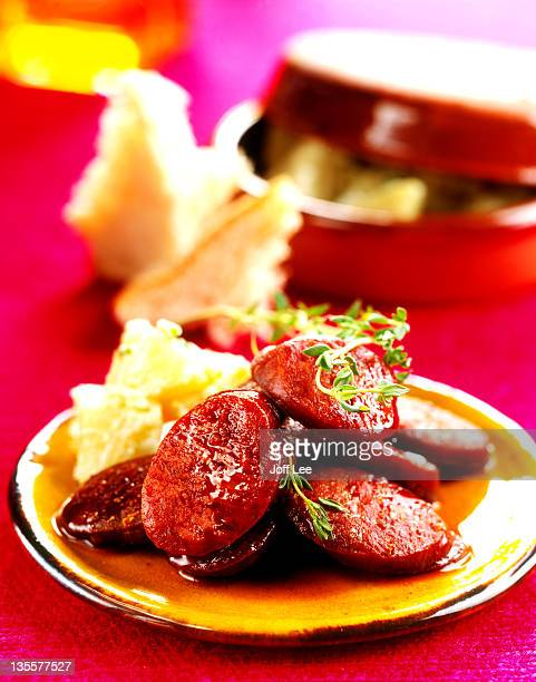 fried chunks of chorizo sausage - tapas - chorizo stock pictures, royalty-free photos & images