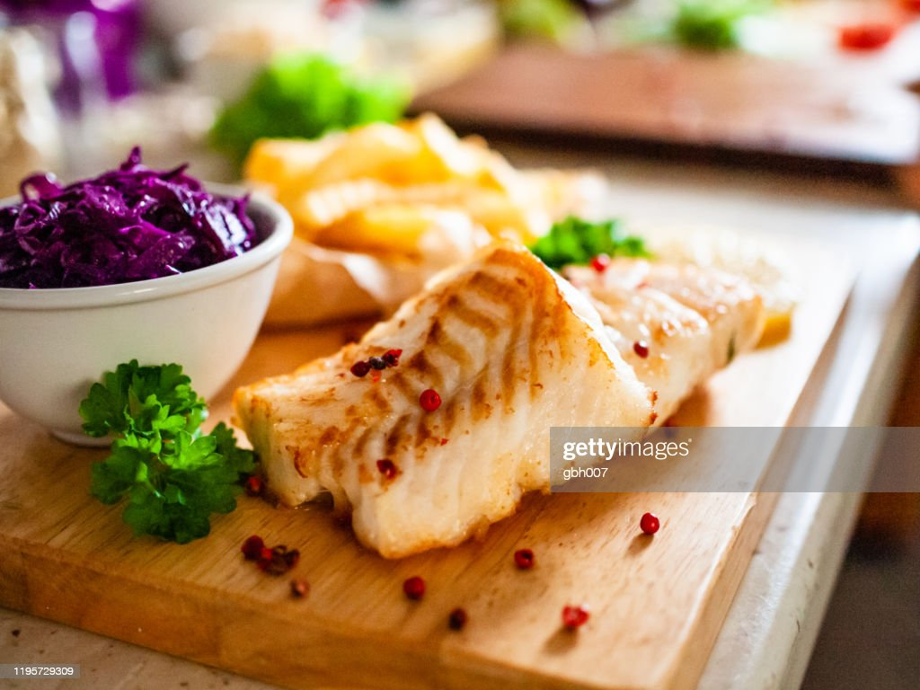 Fried cod fillet with french fries and vegetables : Stock Photo