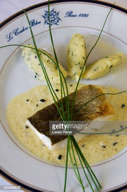 fried cod with pureewith truffles prepared during cooking course in ecole le cordon bleu. - course meal stock pictures, royalty-free photos & images