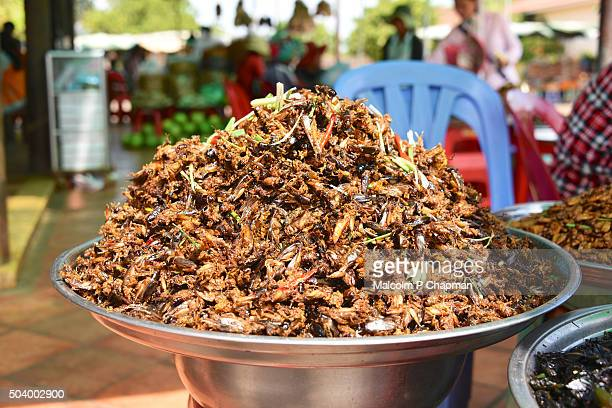 Fried crickets for sale on market stall in Skuon, Phnom Penh, Cambodia